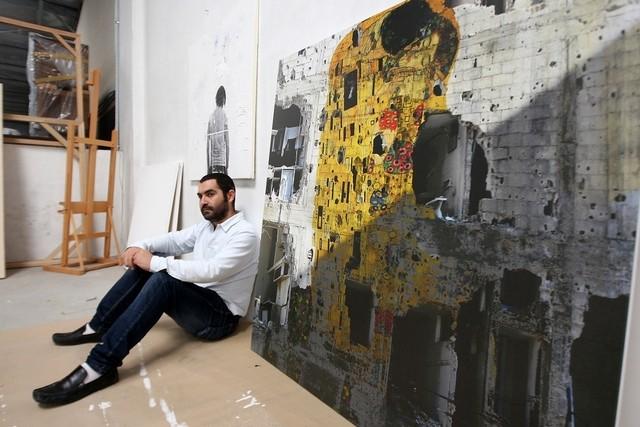 Tammam Azzam with his work, Freedom Graffiti, at Ayyam Gallery in Dubai. Pawan Singh : The National